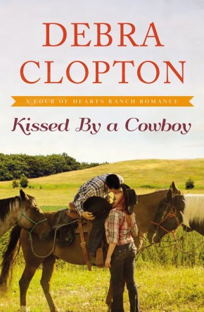Kissed by a Cowboy (A Four of Hearts Ranch Romance) *Scratch & Dent*